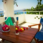 Balcony relaxation at Aegean apartments